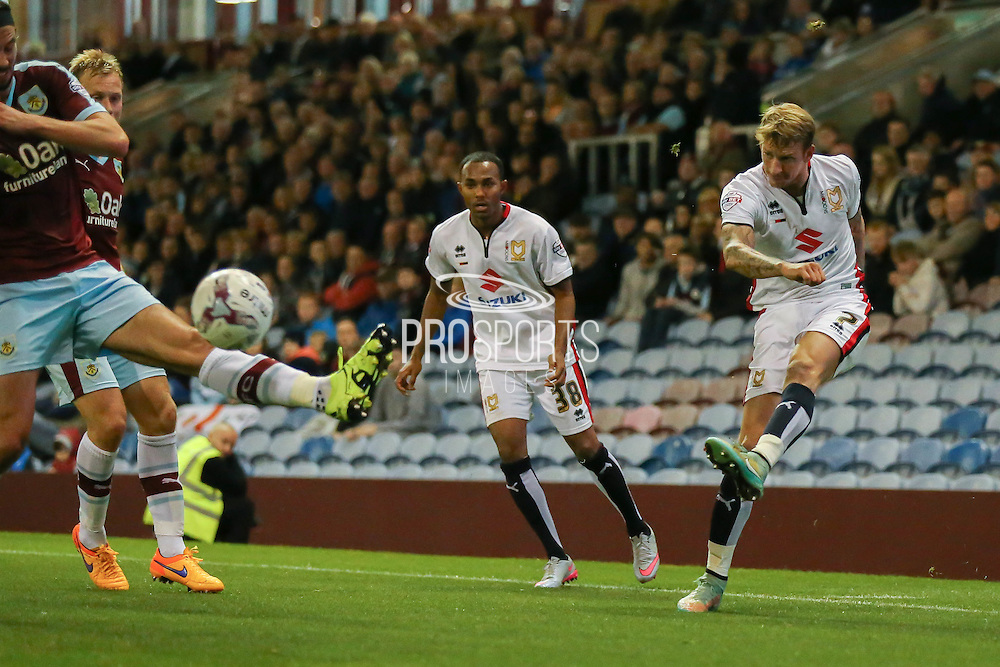 Milton Keynes Dons midfielder Carl Baker crosses the ball in  during the Sky Bet Championship match between Burnley and Milton Keynes Dons at Turf Moor, Burnley, England on 15 September 2015. Photo by Simon Davies.
