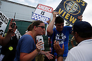 Members of the Westboro Bapist Church talk so Florida law enforcement officers during a rally at the 2012 Republican National Convention on August 28, 2012 in Tampa, Fla. Westboro Baptisit Church members are known for their inflammatory views. Their rally was broken up by a group of proetesters who disagree with their views.