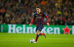 MANCHESTER, ENGLAND - Tuesday, February 18, 2014: FC Barcelona's Lionel Messi in action against Manchester City during the UEFA Champions League Round of 16 match at the City of Manchester Stadium. (Pic by David Rawcliffe/Propaganda)