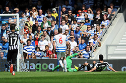 Newcastle United's Emmanuel Riviere scores to make it 0-1 - Photo mandatory by-line: Dougie Allward/JMP - Mobile: 07966 386802 - 16/05/2015 - SPORT - football - London - Loftus Road - QPR v Newcastle United - Barclays Premier League