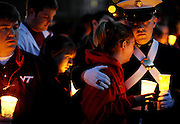 Those inside and outside the Virginia Tech family gathered on the Drillfield for a candlelight vigil in honor of those who were killed or injured during an attack on the campus the day before. On April 16, 2007, a homicidal student opened fire twice within two hours, killing 32 and wounding 17. Seung-Hui Cho committed suicide.