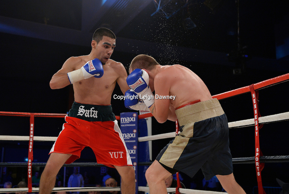 Yusuf Safa (red shorts) defeats Antonio Horvatic in a super featherweight boxing contest at Glow, Bluewater, Kent on the 8th November 2014. Promoter: Hennessy Sports. © Leigh Dawney Photography 2014.