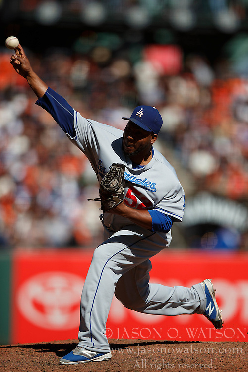 SAN FRANCISCO, CA - OCTOBER 02: Pedro Baez #52 of the Los Angeles Dodgers pitches against the San Francisco Giants during the seventh inning at AT&T Park on October 2, 2016 in San Francisco, California. The San Francisco Giants defeated the Los Angeles Dodgers 7-1. (Photo by Jason O. Watson/Getty Images) *** Local Caption *** Pedro Baez