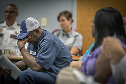 July 27, 2017 - St. Paul, MN, USA - John Thompson, friend of Philando Catile reacts after the Board of Peace Officer Standards and Training voted against a request from Gov. Mark Dayton that a new law enforcement training fund approved by the Legislature this year be named for Philando Castile on Thursday, July 27, 2017 in St. Paul, Minn. (Credit Image: © Elizabeth Flores/TNS via ZUMA Wire)