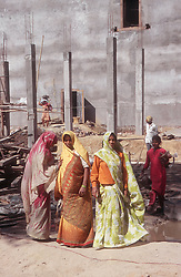 Group of female construction workers on building site wearing traditional dress,