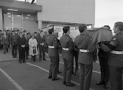 Body of Private Stephen Griffin killed in Lebanon is returned to his home soil..1980-04-19.19th April 1980.19-04-1980.04-19-80..Photographed at Dublin Airport Mortuary..From left: ..Private Stephen Griffin's brother Michael, his aunt Kathleen and his brother  Thomas look on while comrades of the late soldier bear his coffin at the mortuary chapel. The pallbearing party is from the 2nd Garrison Military Police. The coffin is draped in the Irish and United Nations flags.