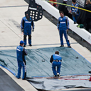 Carl Edwards pit crew curling during a rain delay at the Nationwide Series race at Dover International Speedway in Dover Delaware.
