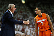 FAYETTEVILLE, AR - NOVEMBER 30:  Head Coach Jim Boeheim talks with Michael Carter-Williams #1 of the Syracuse Orangemen during a game against the Arkansas Razorbacks at Bud Walton Arena on November 30, 2012 in Fayetteville, Arkansas.  The Orangemen defeated the Razorbacks 91-82.  (Photo by Wesley Hitt/Getty Images) *** Local Caption *** Jim Boeheim; Michael Carter-Williams