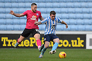 Coventry City midfielder John Fleck and Peterborough United striker Conor Washington battle during the Sky Bet League 1 match between Coventry City and Peterborough United at the Ricoh Arena, Coventry, England on 31 October 2015. Photo by Alan Franklin.