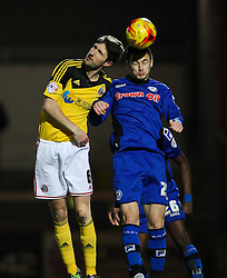 Rochdale's Michael Rose challenges Chris Basham of Sheffield United  - Photo mandatory by-line: Matt McNulty/JMP - Mobile: 07966 386802 - 24/02/2015 - SPORT - Football - Rochdale - Spotland Stadium - Rochdale v Sheffield United - Sky Bet League One