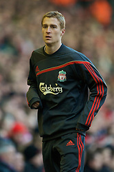 LIVERPOOL, ENGLAND - Saturday, January 30, 2010: Liverpool's substitute Stephen Darby warms-up during the Premiership match against Bolton Wanderers at Anfield. (Photo by: David Rawcliffe/Propaganda)