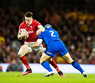 Josh Adams of Wales under pressure from Luca Bigi of Italy<br /> <br /> Photographer Simon King/Replay Images<br /> <br /> Six Nations Round 1 - Wales v Italy - Saturday 1st February 2020 - Principality Stadium - Cardiff<br /> <br /> World Copyright © Replay Images . All rights reserved. info@replayimages.co.uk - http://replayimages.co.uk