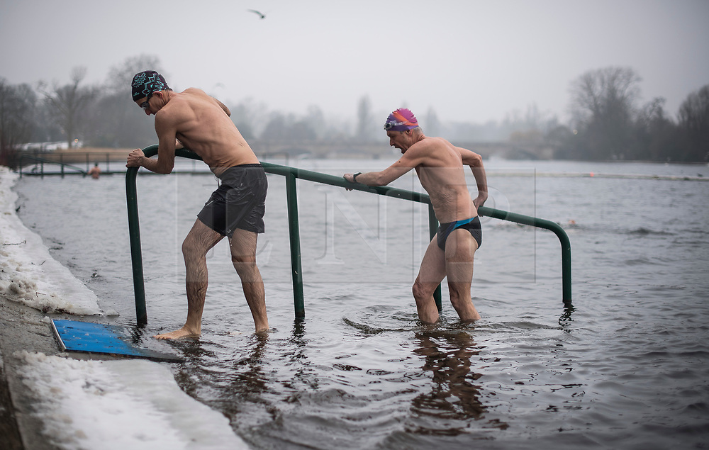 © Licensed to London News Pictures. 03/03/2018. London, UK. Members of the Serpentine Swimming Club brave freezing overnight temperatures as they enjoy an early morning dip at sunrise in the Serpentine in Hyde Park, London. Large parts of the UK are recovering from a week of sub zero temperatures and heavy snowfall, following two severe cold fronts. Photo credit: Ben Cawthra/LNP