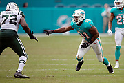 Miami Dolphins defensive end Cameron Wake (91) rushes while trying to work his way around a block attempt by New York Jets offensive tackle Brandon Shell (72) during the NFL week 9 regular season football game against the New York Jets on Sunday, Nov. 4, 2018 in Miami Gardens, Fla. The Dolphins won the game 13-6. (©Paul Anthony Spinelli)