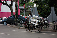 chinese women on bike with aluminium loaded in Shanghai China