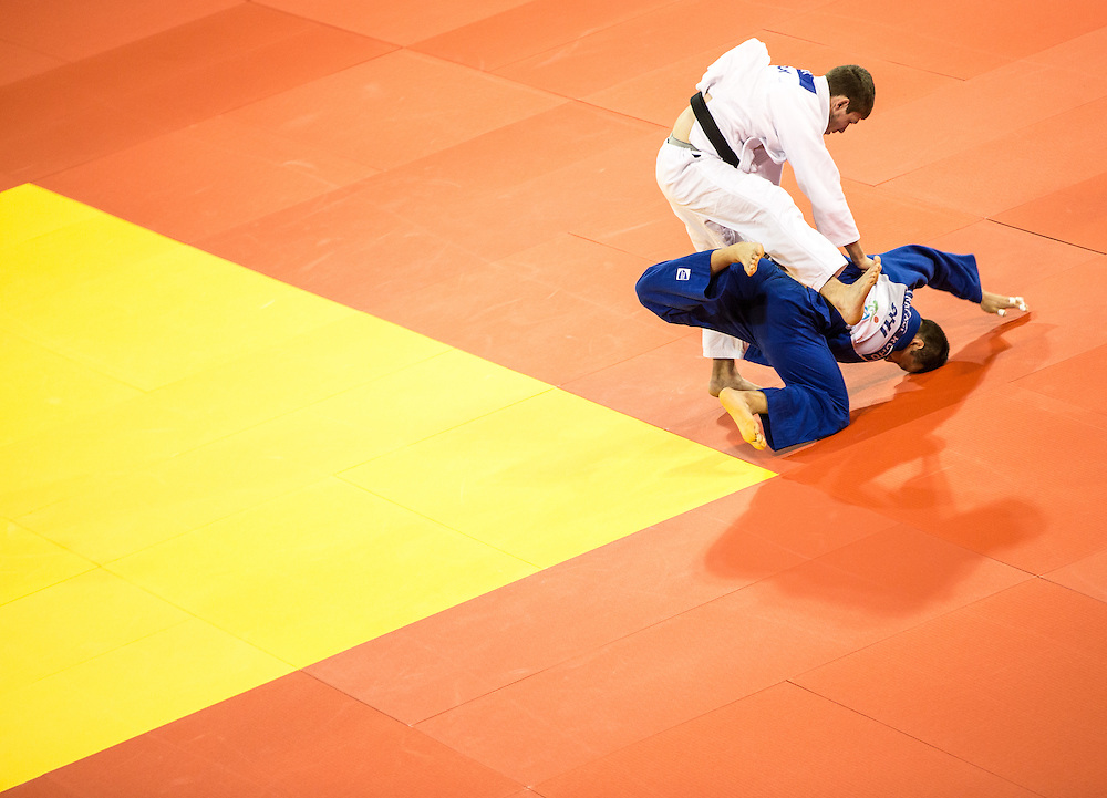 Cristhian Gomera (L- in White) throws Nelson Martinez of Venezuela during their men's judo -90 kg 1/8 final at the 2015 Pan American Games in Toronto, Canada, July 13,  2015.  AFP PHOTO/GEOFF ROBINS