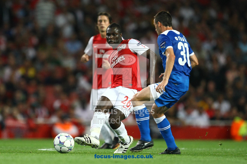 Picture by Paul Chesterton/Focus Images Ltd. 07904 640267.28/9/11.Emmanuel Frimpong of Arsenal and Pablo Orbaiz of Olympiakos in action during the UEFA Champions League Group F match at The Emirates Stadium, London.