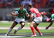 Chris Dry of South Africa attempts to get past Mike Scholz of Canada during the HSBC Sevens World Series Port Elizabeth Leg held at the Nelson Mandela Bay Stadium on 7th December 2013 in Port Elizabeth, South Africa. Photo by Shaun Roy/Sportzpics