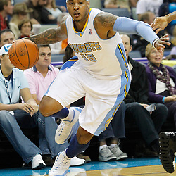 October 29, 2010; New Orleans, LA, USA; Denver Nuggets small forward Carmelo Anthony (15) drives with the ball during the first half against the New Orleans Hornets at the New Orleans Arena.  Mandatory Credit: Derick E. Hingle..