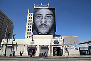 "General overall view of Nike ad featuring former San Francisco 49ers quarterback Colin Kaepernick to commemorate the 30th anniversary of the ""Just Do It"" campaign on the side of building on W. Washington Blvd. between S. Hill Street and S. Broadway in Los Angeles, Friday, Sept., 14, 2018. ""Believe in something,"" the advertisement reads in white letters in front of a black-and-white portrait of Kaepernick. ""Even if it means sacrificing everything."""