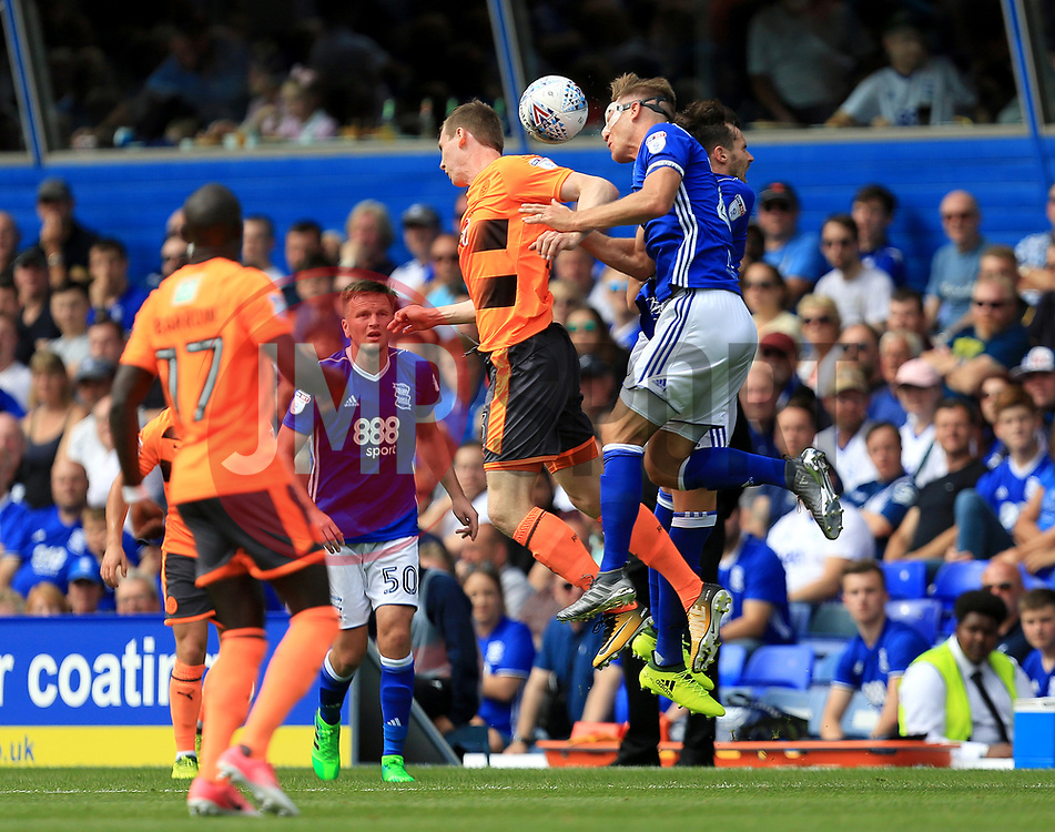Michael Morrison of Birmingham City heads away a reading clearance - Mandatory by-line: Paul Roberts/JMP - 26/08/2017 - FOOTBALL - St Andrew's Stadium - Birmingham, England - Birmingham City v Reading - Sky Bet Championship