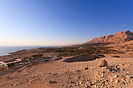 A Nubian ibex surveys the Dead Sea coast and landscape around the Ein Gedi youth hostel, nature preserve, and kibbutz (background). WATERMARKS WILL NOT APPEAR ON PRINTS OR LICENSED IMAGES.