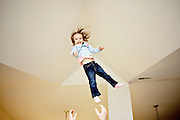 """Air Daddy! Air!"" eighteen-month-old Haley Rucinski shouts until her father, Jonathan, throws her up into the air in a new apartment in Belleville, MI. Rucinski is a single father with joint custody of his daughter."
