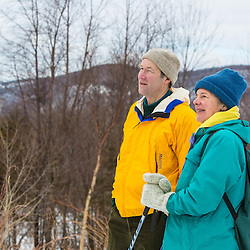 Snowshoers on a bridge over Mendon Brook in Vermont's Green Mountains. Shrewsbury, Vermont.  Jim Jeffords State Forest.