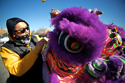 Ducktape is used in a quick on-location repair of one of the lion heads, participating in the annual Philadelphia Suns Lion Dance parade, in Chinatown, Philadelphia.