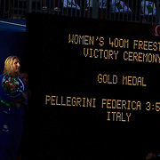 After seeing Federica Pellegrini of Italy break the World Record to win gold in the Women's 400m Freestyle, Rebecca Adlington, who won bronze, looks on at the podium presentation ceremony. Joanne Jackson of Great Britain finished second at the World Swimming Championships in Rome on Sunday, July 7, 2009. Photo Tim Clayton