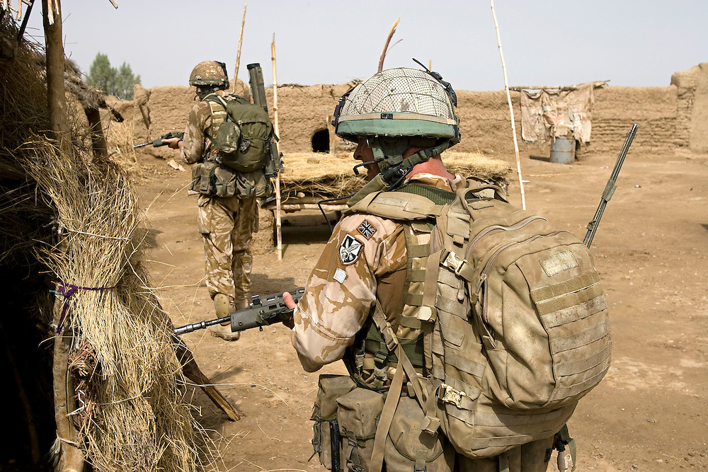 British soldiers of 3rd Battalion The Parachute Regiment search compounds after being dropped by a Chinook Ch-47 helicopter in an airborne assault as part of Operation 'Southern Beast'. Kandahar Province, Afghanistan on the 3rd of August 2008.