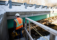 NH DOT workers at the Meredith Center Road bridge on Monday afternoon.  (Karen Bobotas/for the Laconia Daily Sun)