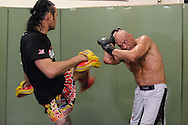 Quentin Chong (left) and Randy Couture work on muay thai striking defence during a training session ahead of UFC 105 at Straight Blast Gym in Manchester, England on November 11, 2009.