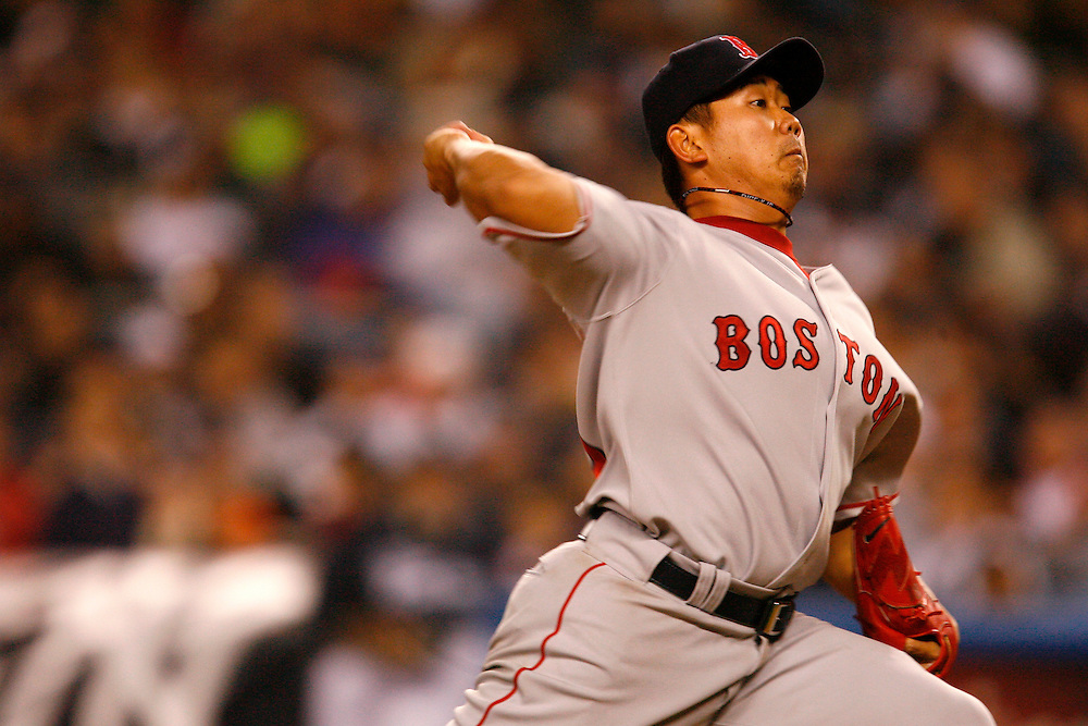 NEW YORK - APRIL 27: Daisuke Matsuzaka #18 of the Boston Red Sox pitches against the New York Yankees at Yankee Stadium on April 27, 2006 in the Bronx borough of New York City  The Red Sox defeated the Yankees 11 to 4.