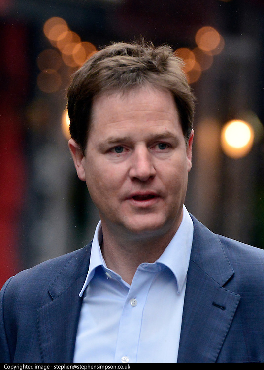"""© Licensed to London News Pictures. 11/04/2013. London, UK. Deputy Prime Minister Nick Clegg leaves his weekly radio show at LBC radio station in Leicester Square, London, today 11th April 2013. He was asked to about comments actress Joan Collins had made on Twitter about wether or not he """"tinted"""" his hair. Mr Clegg laughed off and denied that he did dye his hair. Photo credit : Stephen Simpson/LNP"""