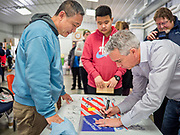 """24 JANUARY 2020 - POLK CITY, IOWA: JOE WALSH signs a banner for a man during a campaign event in Polk City, northwest of Des Moines. Walsh, a conservative radio personality, former Republican congressman, and one time supporter of Donald Trump is now challenging Trump for the Republican nomination for the US Presidency. During his appearance in Polk City, Walsh said Trump is unfit to be the President because he is a """"cheater,"""" a climate change denier, and a """"threat"""" to the United States.     PHOTO BY JACK KURTZ"""