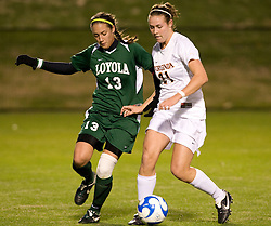 Virginia forward Meghan Lenczyk (21) shields the ball from Loyola defender Heather Cooke (13).  The Virginia Cavaliers defeated the Loyola (MD) Greyhounds 4-1 in the first round of the NCAA Women's Soccer tournament held at Klockner Stadium in Charlottesville, VA on November 16, 2007.
