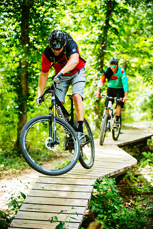 Nathan Woodruff and Chris Crone of Progressive Trail Design riding the All American Trail around Crystal Bridges Museum of American Art in Bentonville, Arkansas.<br />