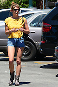 14.AUGUST.2013. LOS ANGELES <br /> <br /> ASHLEY GREENE SHOPPING FOR GROCERIES IN HOLLYWOOD WITH A FRIEND WEARING A TINY SMALL JEANS SHORTS AND A YELLOW BLOUSE.<br /> <br /> BYLINE: EDBIMAGEARCHIVE.CO.UK<br /> <br /> *THIS IMAGE IS STRICTLY FOR UK NEWSPAPERS AND MAGAZINES ONLY*<br /> *FOR WORLD WIDE SALES AND WEB USE PLEASE CONTACT EDBIMAGEARCHIVE - 0208 954 5968*