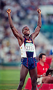 Carl Lewis celebrates after finishing his race. Atlanta Olympics, 1996. Photo: Andrew Cornaga / www.photosport.co.nz