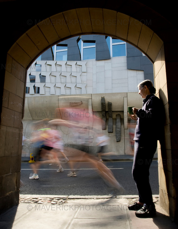 Runners run past the Scottish Parliament  as 10,000 Runners take part in the 10km Bupa Great Edinburgh Run 3/5/09.Picture Michael Hughes/Maverick