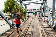 18 JUNE 2013 - YANGON, MYANMAR:   Stevedores unload a river freighter on the docks in Yangon, Myanmar.     PHOTO BY JACK KURTZ