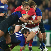 Jamie Roberts, Wales, is tackled during the Wales V France Semi Final match at the IRB Rugby World Cup tournament, Eden Park, Auckland, New Zealand, 15th October 2011. Photo Tim Clayton...