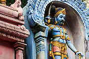 07 JANUARY 2014 - SINGAPORE:  Deities at Sri Veeramakaliamman Temple, a Hindu temple located in Little India in the southern part of Singapore. The Sri Veeramakaliamman Temple is dedicated to the Hindu goddess Kali, fierce embodiment of Shakti and the god Shiva's wife, Parvati. Kali has always been popular in Bengal, the birthplace of the labourers who built this temple in 1881. Images of Kali within the temple show her wearing a garland of skulls and ripping out the insides of her victims, and Kali sharing more peaceful family moments with her sons Ganesha and Murugan. The building is constructed in the style of South Indian Tamil temples common in Tamil Nadu as opposed to the style of Northeastern Indian Kali temples in Bengal. PHOTO BY JACK KURTZ