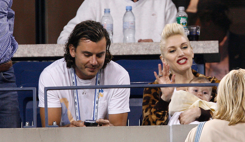 British actor Gavin Rossdale (L) sits with his wife US singer Gwen Stefani holds their son Kingston James McGregor as she watches Roger Federer of Switzerland play James Blake of the US in their quarterfinals round match on the eleventh day of the 2006 US Open tennis tournament in Flushing Meadows New York Thursday 07 September 2006. ..