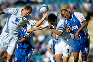 Picture by Ady Kerry/Focus Images Ltd.  .26/09/09.Gillingham's Josh Gowling challenges Norwich's Grant Holt during their Coca-Cola League 1 game at the Priestfield Stadium, Gillingham, Kent.