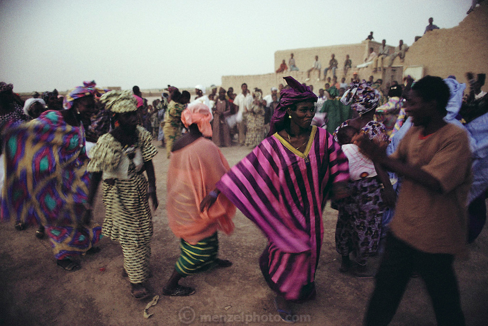 Ramadan is the month for fasting, prayer, weddings, and other social activities. At the end of Ramadan, the entire village of Kouakourou, Mali, celebrated with a community dance. Published in Material World, page 17.