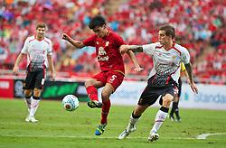 BANGKOK, THAILAND - Sunday, July 28, 2013: Liverpool's Daniel Agger in action against Thailand XI during a preseason friendly match at the Rajamangala National Stadium. (Pic by David Rawcliffe/Propaganda)