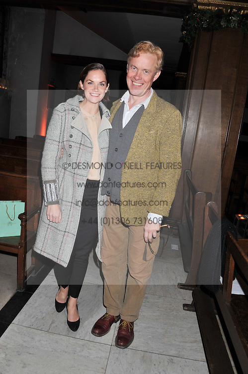 RUTH WILSON and ALEX JENNINGS at the Fayre of St. James Christmas Carol Service organised by the Quintessentially Foundation in aid of War Child held St.James's Piccadilly, London on 29th November 2012.