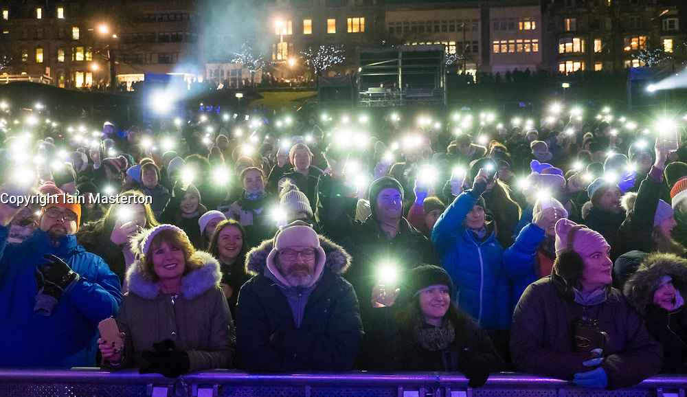 Edinburgh, United Kingdom. 9 December,2017. Sleep in the Park, held in Princes Street Gardens in Edinburgh, will see almost 9000 people sleep outdoors to raise money and awareness of homelessness. The event is organised by Social Bite and starts with a music concert. View of audience with mobile phone lights switched on.